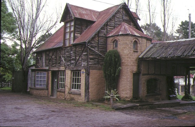 1 montsalvat hillcrest avenue eltham front view stone & wood house