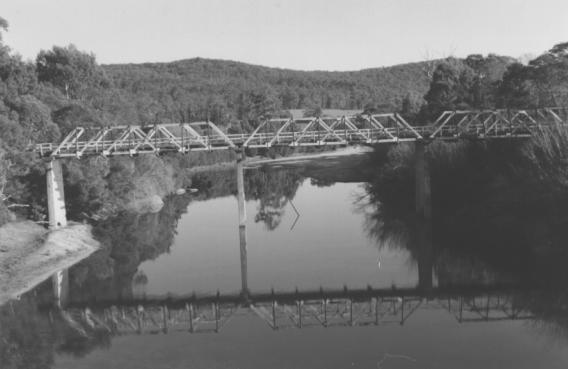 h01214 genoa river timber and concrete bridge b w photo