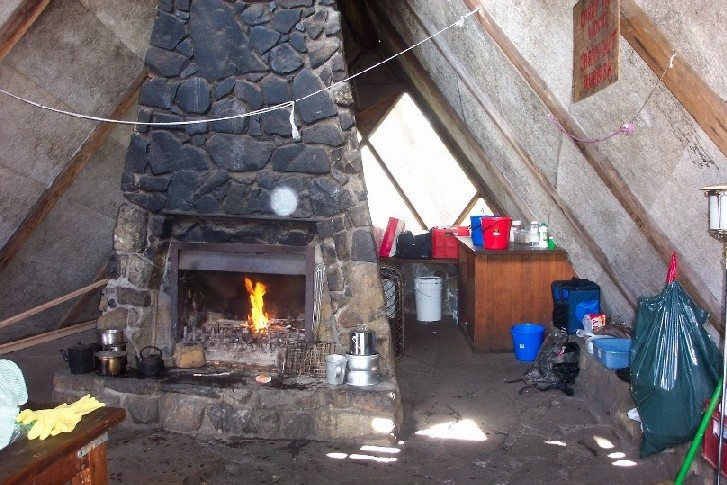 h00046 gantner hut interior with fireplace feb2005 as 006