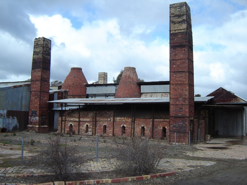1 Bendigo Pottery North West Facade and Rectangular Kiln 2 (S9), Bottle Kilns 3 & 4 (S3 & S4) and Chimneys 1, 2 & 3 (S10,S11 & S12)16 August 2005 mz