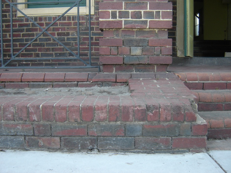 H1343 Exterior - East (front) facade, dislodged brickwork and missing mortar. Dec 2006.