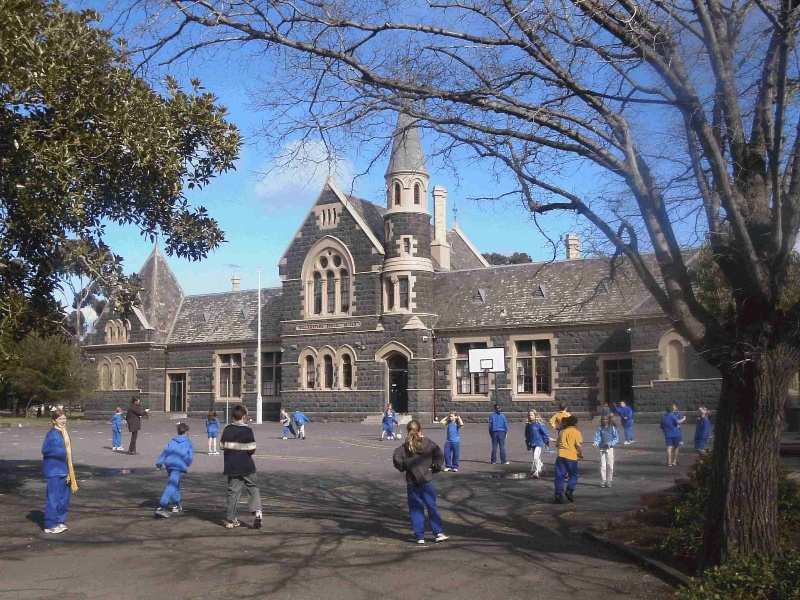 Williamstown Primary School No. 1183, Hobsons Bay Heritage Study 2006 - image shows another view of the school, framed by trees including a Moreton Bay Fig (left) and a Dutch Elm (right) along the Cecil Street frontage.