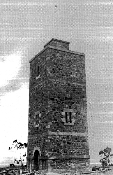 68 - War Memorial and Components Eltham Yarra Gl Rd - Old photograph taken after the completion of the tower, but prior to the installation of the main metal plaque fixed above the arch ELHPC no.406 - Shire of Eltham Heritage Study 1992