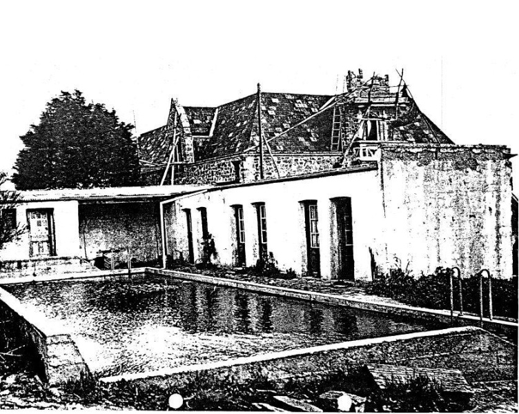 133 - Montsalvat Hillcrest Ave Eltham 13 - 1949? Photograph showing the swimming pool and behind, the great hall still being constructed - NOTE the visible construction of the side wall of the swimming pool building - Shire of Eltham Heritage Study 1992