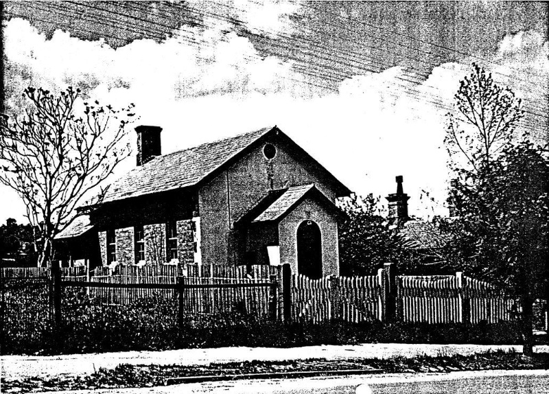 199 - Court House 730 Main Rd Eltham 02 - 1949? photograph showing the court house, previous/original timber picket fence, site planting and the police residence chimneys - Shire of Eltham Heritage Study 1992