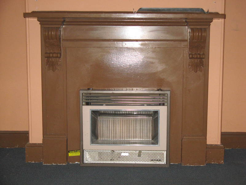 timber fire surround in front room