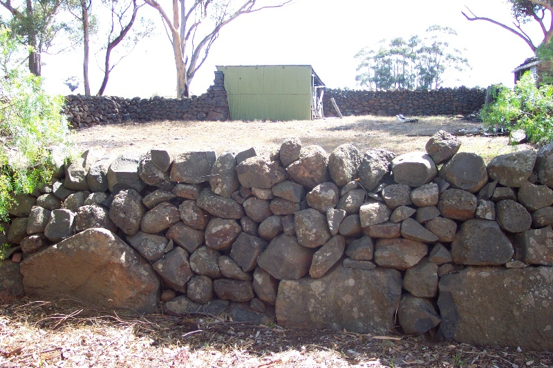 Dry stone wall stock yard