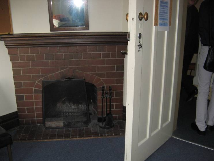 Fireplace in a student room of the 1930 Traill Wing