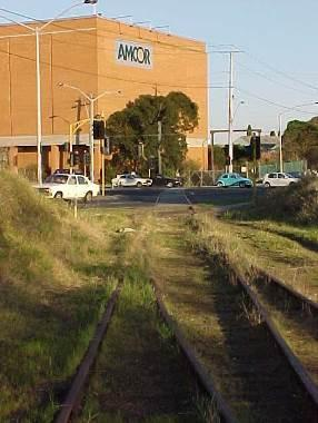 Tracks at the former site of the Fulham Grange Station (now removed) approaching the Chandler Highway Bridge.jpg