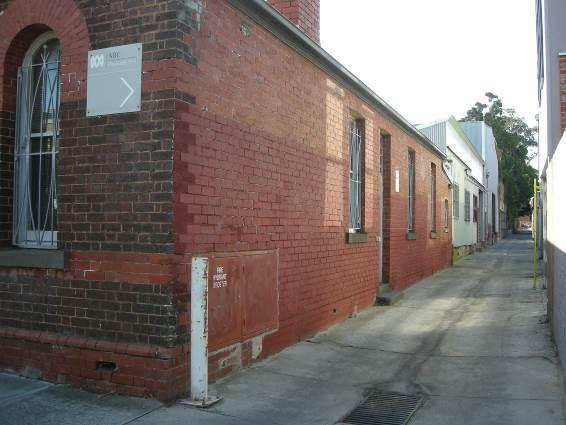 View from Selwyn Street along un-named laneway, showing painted areas of face brickwork on south elevation