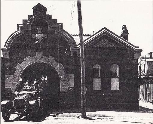 c.1918: Selwyn Street elevation with Hotchkiss Fire Engine and crew. The Station's original roof materials are visible