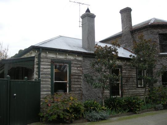 Mid-1980s single-storey addition on left, c.1882 polygonal bayed wing on right.