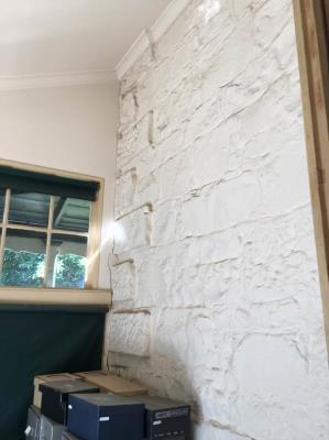 Within enclosed north verandah, looking at painted stone wall at northeast corner of Former Manse
