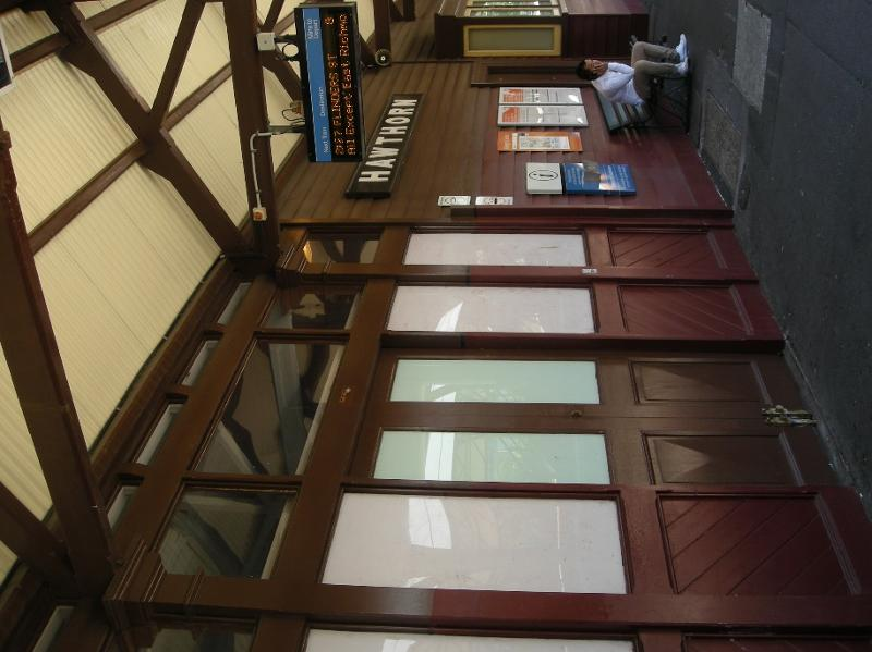 Platform 1 - timber-framed glazed doors, sidelights and early wall-mounted Station nameboard