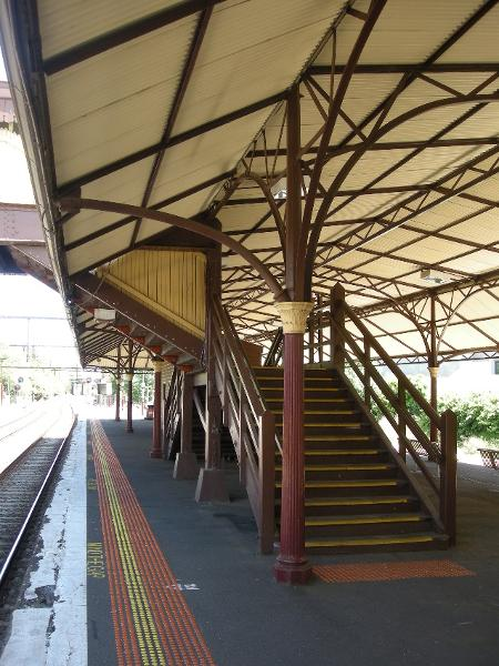 The roofed footbridge and its access stairs links the two Platforms at their mid-points