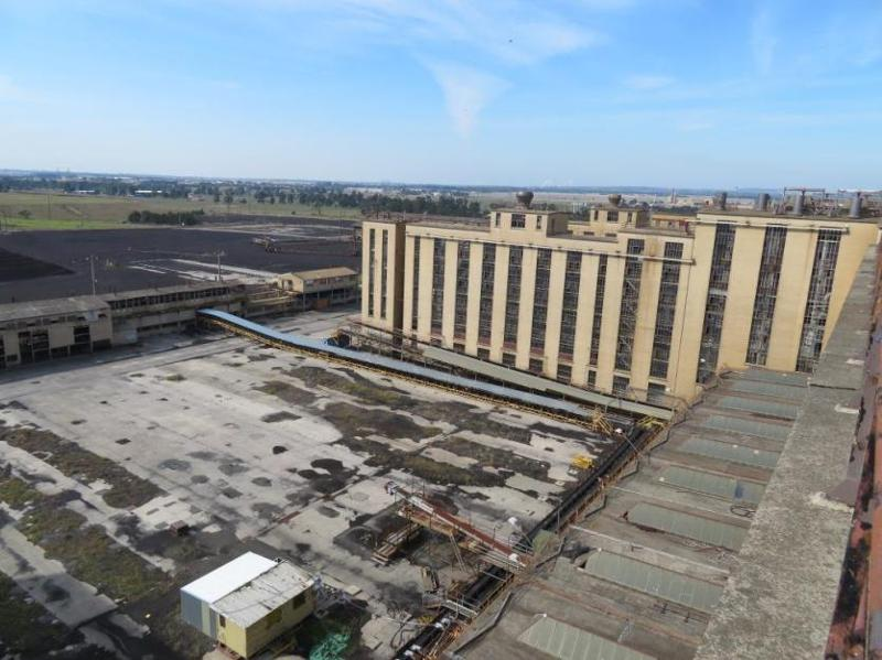 View northeast from the top of No.1 Briquette Factory looking at side of the Briquette Factory (right) and the collecting and feeding conveyors (left)