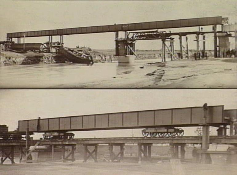 1896 Girders being moved into place with trolleys.jpg